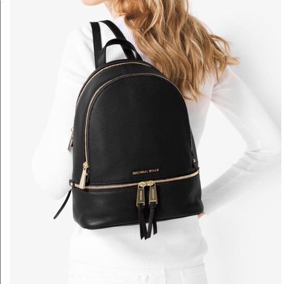 3332a1acd39611 Michael Kors Rhea Medium Backpack. M_5a81e3d22ab8c5ac0783ad61